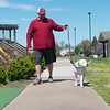 David DuRall II walks his dog Casper at Cunningham Park on Friday afternoon.<br /> Globe | Roger Nomer