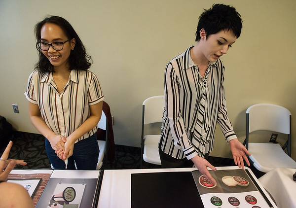Dorothy Gonzales, a Missouri Southern senior from Joplin, left, and Ashton McGehee, a MSSU junior from Neosho, talk about their design work during Wednesday's Student Research Symposium at MSSU.<br /> Globe | Roger Nomer