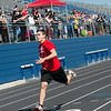Ethan Seaton, 18, Lamar, finishes the 200-meter race during Tuesday's regional Special Olympics track meet at Carthage High School.<br /> Globe | Roger Nomer