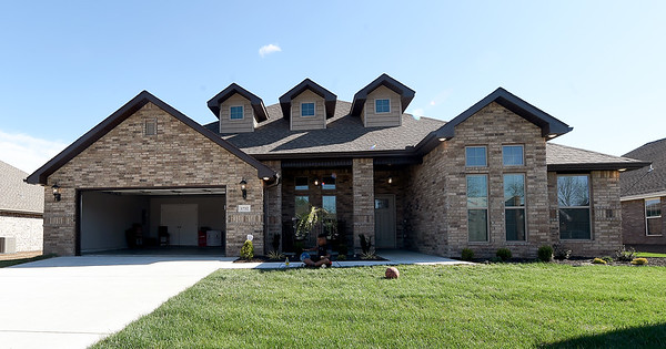 The new St. Jude's Dream Home, which will be raffled on May 22, sits at 1752 Kent Dr. in Webb City on Thursday. Tours of the $275,000 home will be offered from April 13to May 19. The house features four bedrooms and three bathrooms.<br /> Globe   Laurie Sisk