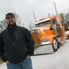 Kyle Cousins talks about the award-winning truck at Fleenor Brothers Trucking on Thursday.<br /> Globe | Roger Nomer