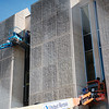 Workers replace windows at Pittsburg State University's Axe Library on Wednesday afternoon.<br /> Globe | Roger Nomer