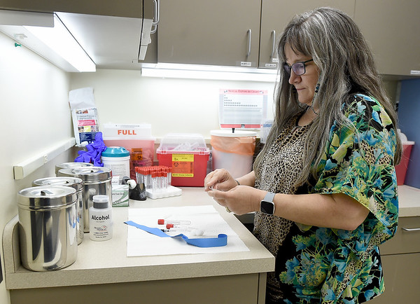 Joplin Public Health Medical Services Coordinator demonstrates preparations to treat sexuallty transmitted infections on Tuesday at the health department.<br /> Globe | Laurie SIsk