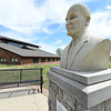 A bust of George Washington Carver stands behind the main building at the George Washington Carver National Monument on Wednesday.<br /> Globe | Laurie Sisk