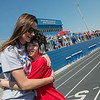 Payton Littlejohn, 15, Lamar, gets a hug at the finish line from Lauren Compton, 18, during Tuesday's regional Special Olympics track meet at Carthage High School.<br /> Globe | Roger Nomer