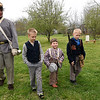 From the left: Jack Davis, 15, leads Fisher Strawn, 10, Inman Walker, 5 and Trapper Strawn, 8 in marching drills during the Fourth Annual Hammer In event on Saturday in Newtonia. The event featured Civil War reeanactors, blacksmiths, tours and more during the day long event.<br /> Globe | Laurie Sisk