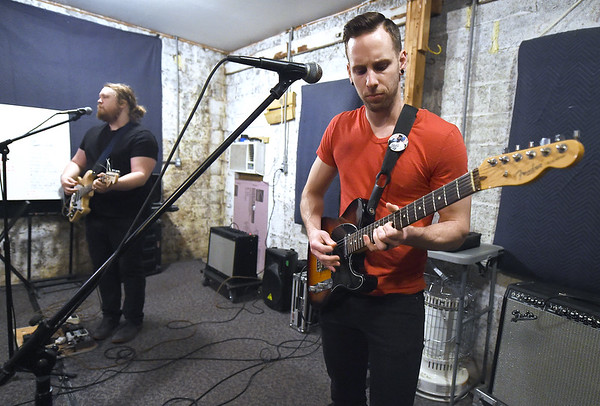 """Me Like Bees"" guitarists Luke Sheafer and Pete Burton rehearse with the popular rock band on Thursday at their rehearsal space. The band has managed to balance both their work and band lives, performing multiple gigs.<br /> Globe 