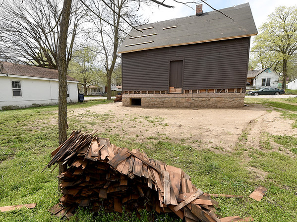 Original shingles from the Neosho Colored School sit behind the school, which awaits a new, historically accurate roof.<br /> Globe | Laurie Sisk