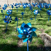 Blue pinwheels spin in the breeze on the front lawn of the Joplin Police Department on Monday. The pinwheel garden marks the observance of April as child abuse prevention month.<br /> Globe | Roger Nomer