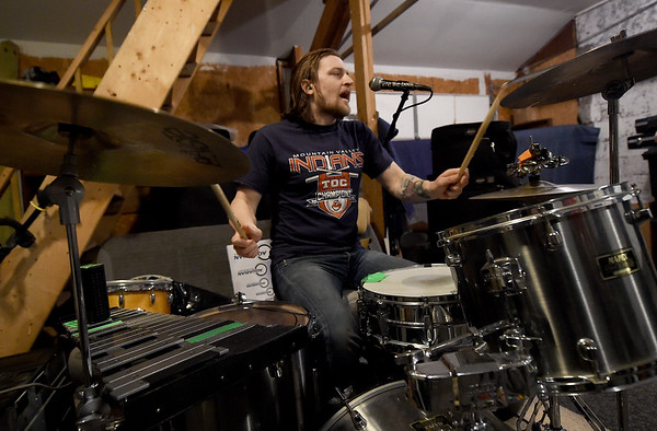 """""""Me Like Bees"""" drummer Lewis Brossman rehearses with the popular rock band on Thursday at their rehearsal space. The band has managed to balance both their work and band lives, performing multiple gigs.<br /> Globe 