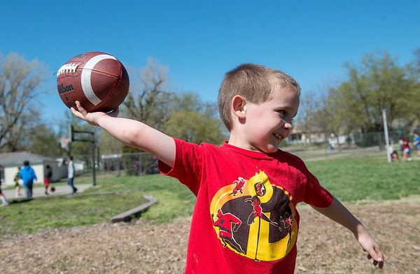 Steven Kreeger, 6, throws a football at the Boys and Girls Club of Joplin on Monday.<br /> Globe | Roger Nomer