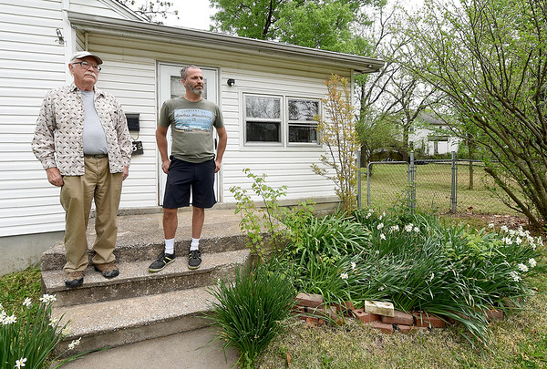 From the left: Kitty Dyer's husband, Dennis Burghart and son, Aaron Dyer, stand outside Kitty's rental property on Tuesdatat 113 S. Jackson. Aaron Dyer stands inside a gravel floor garage at his mother's rental property at 113 South Jackson on Tuesday. The duo contend that while under management by Keller Williams Property Management's Steve Jones, homeless camps were set up inside out buildings and on the grounds of Kitty Dyer's property causing damage to the house and the grounds.<br /> Globe | Laurie Sisk
