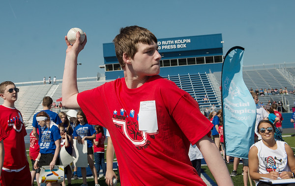 Nathan Demoss, 15, Lamar, competes in the softball throw during Tuesday's regional Special Olympics track meet at Carthage High School.<br /> Globe | Roger Nomer