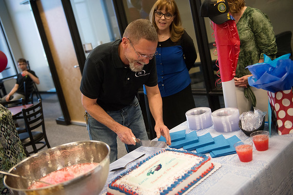 Franklin Tech teachers Lorin Curtis cuts the first piece of his cake after being named Joplin teacher of the year on Tuesday.<br /> Globe | Roger Nomer