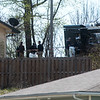 Officers process a scene in southwest Joplin on Wednesday afternoon.<br /> Globe | Roger Nomer