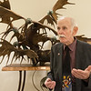 Larry Glaze talks about the addition of a young eagle to his sculpture at Mercy Hospital on Thursday.<br /> Globe | Roger Nomer