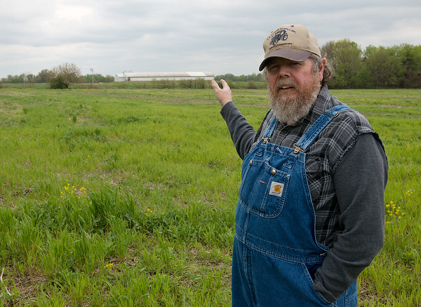 Darvin Bentlage talks about a corporate hog farm bordering his land near Golden City on Thursday.<br /> Globe | Roger Nomer