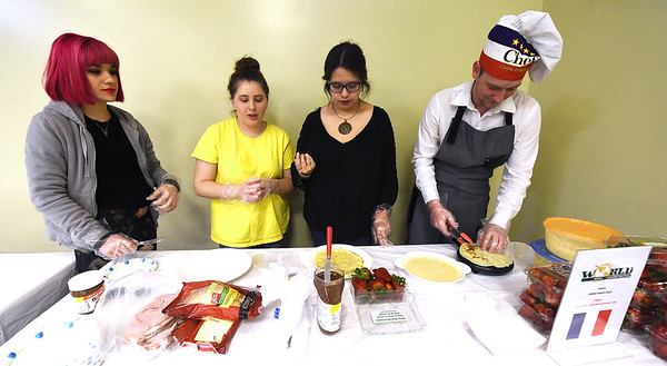 From the left: Missouri Southern French Club members Maya Strick, Jillian Canterbury, Josalynn Alvarado and Dillon Henson prepare crepes during the MSSU World Cuisine and Music Festival on Saturday at the Billingsley Student Center. The sixth annual event featured a variety of international dishes and music from across the globe.<br /> Globe | Laurie Sisk
