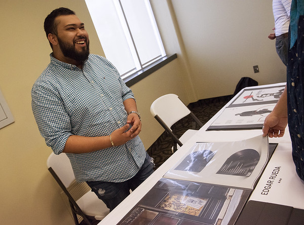 Edgar Rueda, a Missouri Southern junior from Joplin, talks about his design work during Wednesday's Student Research Symposium at MSSU.<br /> Globe | Roger Nomer