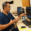 Frank S. Kim, cardiologist at Freeman Hospital, talks about heart health at a Freeman cardio clinic on Wednesday.<br /> Globe | Roger Nomer