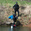 Divers search a pond on Crane road in southwest Joplin on Friday.<br /> Globe | Roger Nomer