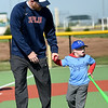 Five-year-old Duke Reid spares the bat flip after hitting a grand slam on Opening Day for Miracle League Baseball on Saturday at the Will Norton Miracle Field. Escorting Duke is his father, Nick Reid.<br /> Globe | Laurie Sisk