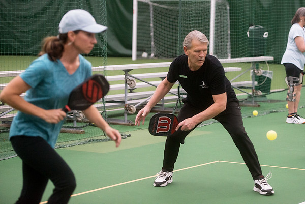 CJ Irlam and Jerry Rolland play a game of Pickleball at Millennium Family Fitness on Thursday.<br /> Globe | Roger Nomer