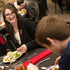 Savannah Kratzbert, Pittsburg State junior, talks with high school students during an etiquette lunch at PSU on Wednesday.<br /> Globe | Roger Nomer