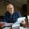 Keith Adams talks about an invoice he received that was determined to be Medicare fraud during an interview on Tuesday at his home in Joplin.<br /> Globe | Roger Nomer
