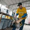George Greenlee, Joplin, recycles materials at the Joplin Recycling Center on Wednesday.<br /> Globe | Roger Nomer