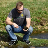Missouri Southern student Cameron Priester looks for snails at the MSSU biology pond on Wednesday afternoon. Snails from the pond are used as controls for experiments using liquified snails as tests for soil and water quality in mined areas.<br /> Globe | Laurie SIsk