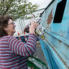 Myra Hunt, Galena, recycles newspapers on Wednesday at the Joplin Recycling Center.<br /> Globe | Roger Nomer