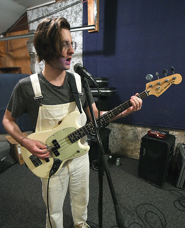 """Me Like Bees"" bass player Jake Bennett rehearses with the popular rock band on Thursday at their rehearsal space. The band has managed to balance both their work and band lives, performing multiple gigs.<br /> Globe 