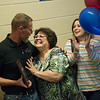 Franklin Tech teacher Lorin Curtis is congratulated by his wife Tomoko Curtis, and Kasey Campbell, daughter, on Tuesday after being named Joplin teacher of the year.<br /> Globe | Roger Nomer