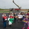 St. Mary's Elementary Pre-Kindergarten students gather for a photo with their protective egg containers during Thursday's Humpty Dumpty Day at the school. Students crafted egg containers with their parents, and members of the Joplin Fire Department dropped the containers from a ladder truck.<br /> Globe | Roger Nomer