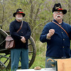 Civil War reenactor Dennis Gibbons, of the Wilson's Creek Artillery Crew, holds an artillery cannister for a cannon as Bob Kriesky looks on during the Fourth Annual Hammer In event on Saturday in Newtonia. The event featured Civil War reeanactors, blacksmiths, tours and more during the day-long event.<br /> Globe | Laurie Sisk