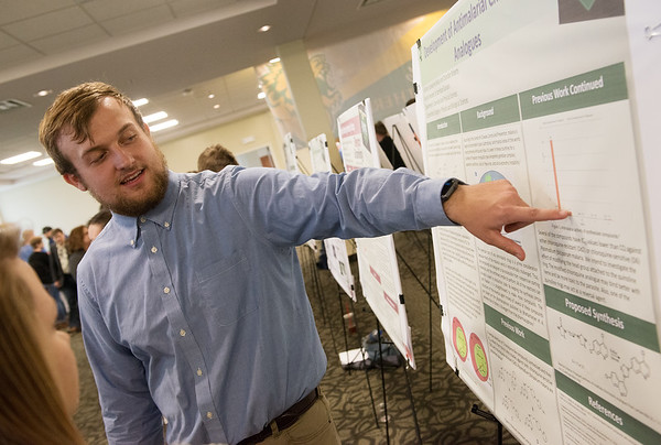 Chandler Roberts, a Missouri Southern sophomore from Ava, talks about a research project he created with partner Jacqueline Ballay, a MSSU junior from Monett, during Wednesday's Student Research Symposium at MSSU.<br /> Globe | Roger Nomer