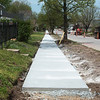 New sidewalks are being constructed along Joplin Street on Tuesday afternoon.<br /> Globe | Roger Nomer