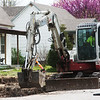 Crews demolish a sidewalk in south Joplin on Tuesday afternoon.<br /> Globe | Roger Nomer