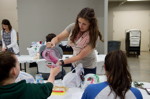 Lindsey Stevenson, with the University of Missouri Extension, distributes samples of a berry beet smoothie on Monday at the Lion Co-op at Missouri Southern.<br /> Globe | Roger Nomer