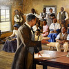 A Mike Wimmer painting depicting what life could have been like inside the Neosho Colored School hangs inside the George Washington Carver National Monument on Wednesday. <br /> Globe | Laurie SIsk