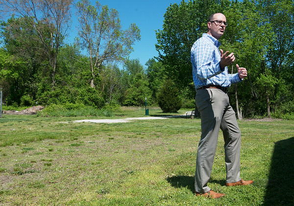 Mark Johnson, former board member of the Joplin Humane Society, talks about improvements to be made to the walking trail to be made with proceeds from the Joplin Memorial Run on Friday.<br /> Globe | Roger Nomer