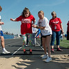 Grace O'Neal, Carthage High senior, helps steady Rebecca Gaskins, a junior at Carl Junction High School, in the long jump during Tuesday's regional Special Olympics track meet at Carthage High School.<br /> Globe | Roger Nomer