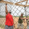 From the left: AT&T employees Kellen Kitchens and Andy Robeson restore a dugout on Tuesday afternoon at the old Redden Field. The field is the last free-use ball field in Joplin and AT&T employees welcome members of the community to help restore the field on Saturday.<br /> Globe | Laurie Sisk
