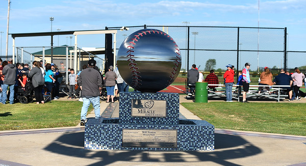 Fans fill the stands for the Opening Day of Miracle League Baseball on Saturday morning at the Joplin Athletic Complex. Earlier forecasts of rain were nullified by windy but dry conditions for the annual event.<br /> Globe | Laurie Sisk