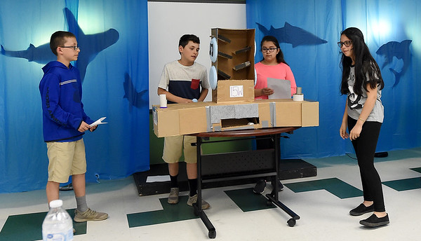 """From the left: Carthage Intermediate Center sixth graders Colt and Dylan Pugh, Alondra Gomez and Stephanie Palma present a prototype of their """"sound box"""" during a """"Shark Tank"""" themed competition aimed at designing toys for kids with cerebral palsy on Wednesday at CIC. . <br /> Globe 