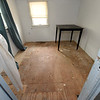 A floor damaged by pet feces and urine stands exposed after the carpet was removed to repair the house on Tuesday at 113 S. Jackson. The owner contends that while under management by Keller Williams Property Management's Steve Jones, homeless camps were set up inside out buildings and on the grounds of Kitty Dyer's property causing damage to the house and the grounds.<br /> Globe | Laurie Sisk