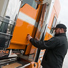 Kyle Cousins opens the door to the award-winning truck at Fleenor Brothers Trucking on Thursday.<br /> Globe | Roger Nomer