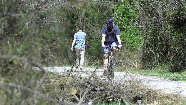 Cyclist Joel Stewart, of Pittsburg, makes his way along the Frisco-Greenway Trail near Division street on Wednesday. Stewart, formerly of Joplin, said he enjoys coming back to Joplin to ride the trail.<br /> Globe | Laurie SIsk