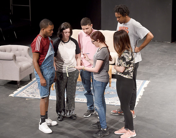 """Missouri Southern student director Bailee Lewis, center, reviews notes with the cast of """"Abra Cadaver"""" on Tuesday night at the Black Box Theatre. The dark comedy is one of eight student directed one act plays to be presented over three nights. From the left: Kendrick Carlock, Shelby Bryant, Michael Rivera, Lewis, Robert Humphrey and Molly Sanders.<br /> Globe   Laurie SIsk"""